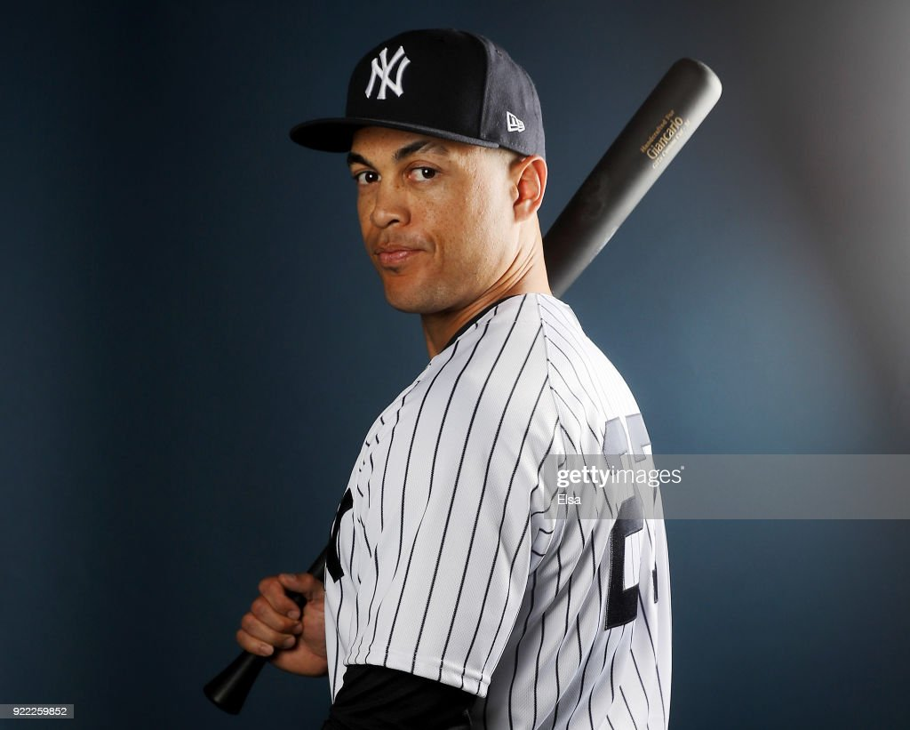 Giancarlo Stanton #27 of the New York Yankees poses for a portrait during the New York Yankees photo day on February 21, 2018 at George M. Steinbrenner Field in Tampa, Florida.