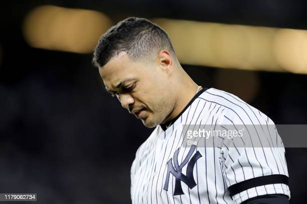 Giancarlo Stanton of the New York Yankees reacts after grounding out against the Minnesota Twins during the first inning in game one of the American...
