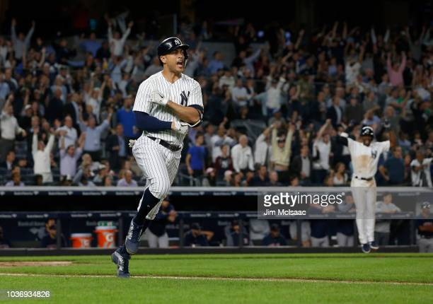 Giancarlo Stanton of the New York Yankees reacts after his fourth inning grand slam home run against the Boston Red Sox at Yankee Stadium on...
