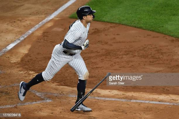 Giancarlo Stanton of the New York Yankees reacts after hitting a home run during the fourth inning against the Toronto Blue Jays at Yankee Stadium on...