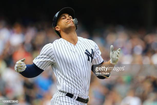 Giancarlo Stanton of the New York Yankees reacts after lining out to right field to end the inning leaving the bases loaded in the sixth inning...