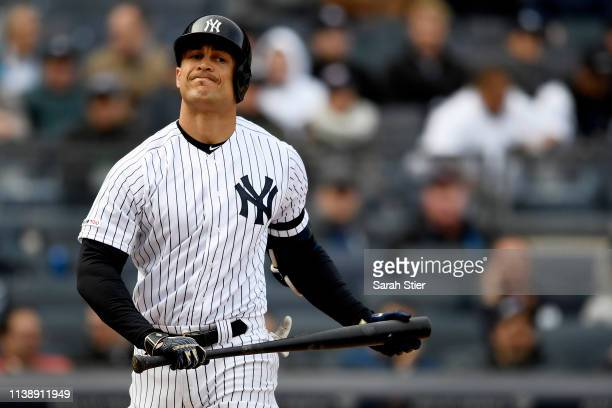 Giancarlo Stanton of the New York Yankees reacts after striking out during the eighth inning of the game against the Baltimore Orioles during Opening...