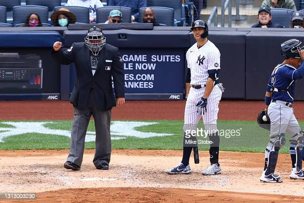 Giancarlo Stanton of the New York Yankees reacts after striking out in the fifth inning against the Tampa Bay Rays at Yankee Stadium on April 17,...