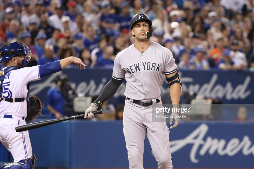 Giancarlo Stanton #27 of the New York Yankees reacts after striking out in the eighth inning during MLB game action against the Toronto Blue Jays at Rogers Centre on July 6, 2018 in Toronto, Canada.