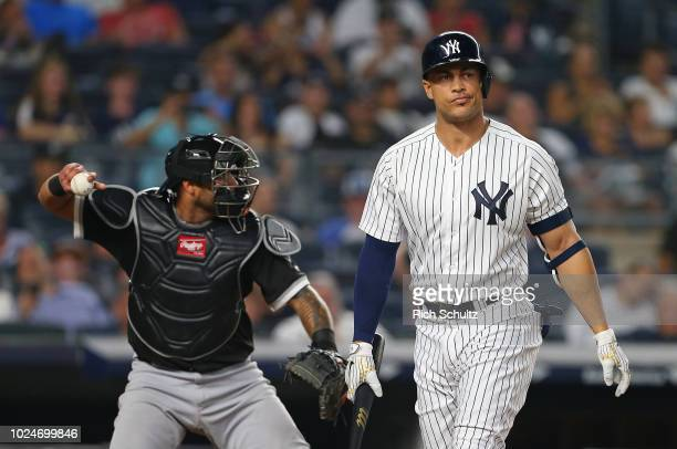 Giancarlo Stanton of the New York Yankees reacts to striking out during the sixth inning of a game against the Chicago White Sox at Yankee Stadium on...