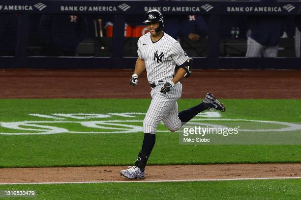 Giancarlo Stanton of the New York Yankees rounds the bases after hitting a two-run home run in the third inning against the Houston Astros at Yankee...
