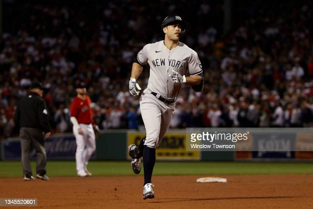 Giancarlo Stanton of the New York Yankees rounds the bases after his home run against the Boston Red Sox during the AL Wild Card playoff game at...