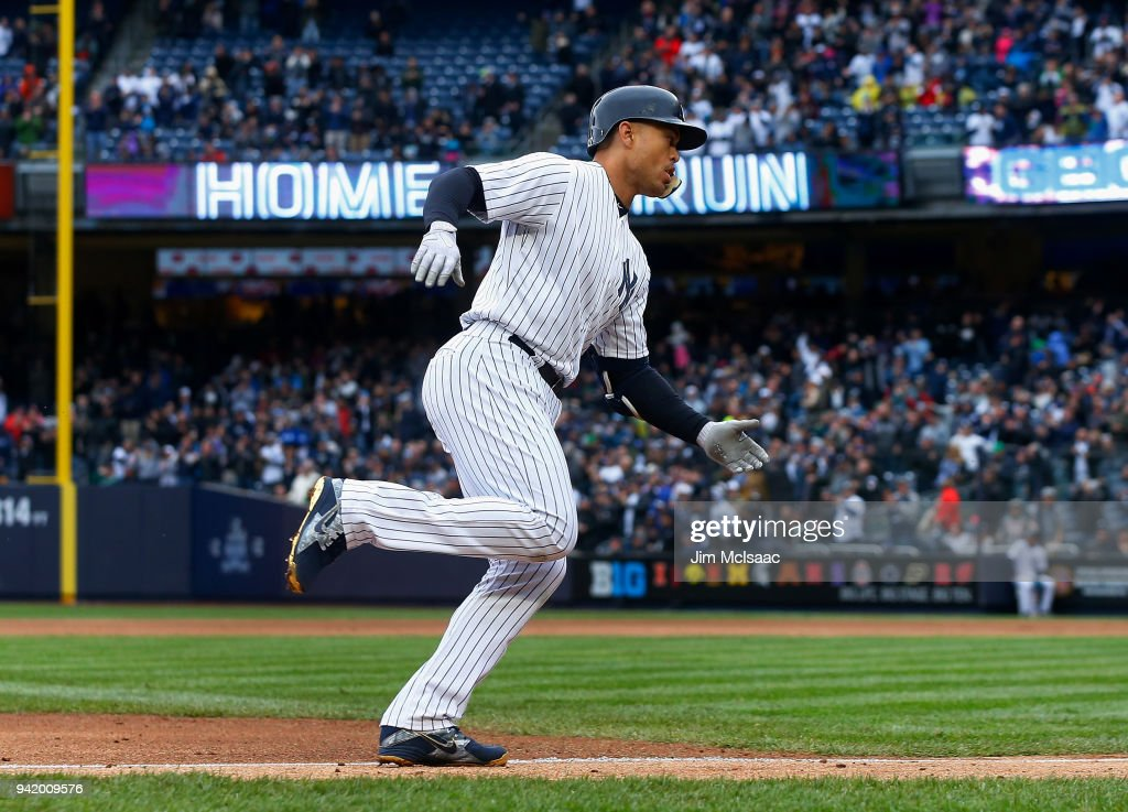 Giancarlo Stanton #27 of the New York Yankees runs the bases after his first inning two-run home run against the Tampa Bay Rays at Yankee Stadium on April 4, 2018 in the Bronx borough of New York City.