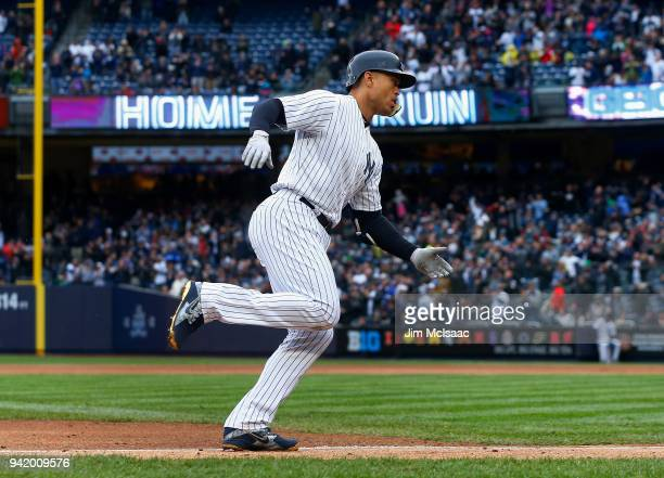 Giancarlo Stanton of the New York Yankees runs the bases after his first inning tworun home run against the Tampa Bay Rays at Yankee Stadium on April...