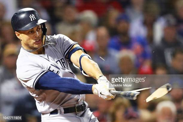 Giancarlo Stanton of the New York Yankees splits his bat hitting a single during the fourth inning against the Boston Red Sox at Fenway Park on...