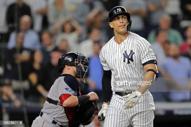 Giancarlo Stanton of the New York Yankees strikes out in the ninth inning against the Boston Red Sox during Game Four American League Division Series...