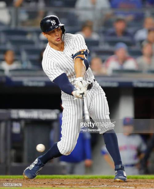 Giancarlo Stanton of the New York Yankees swings and misses for strike three to strikeout in the fifth inning in an interleague MLB baseball game...
