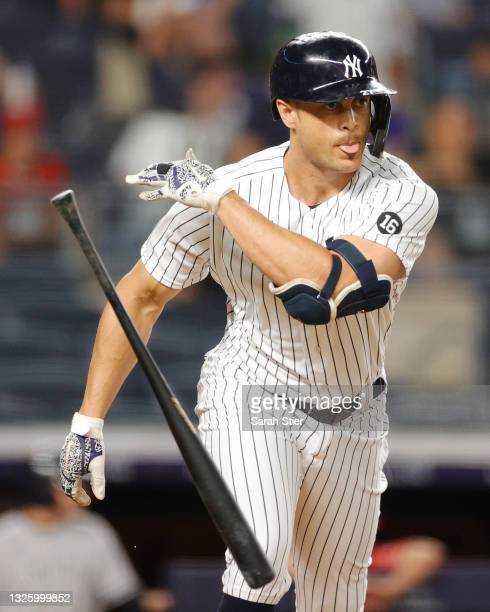 Giancarlo Stanton of the New York Yankees tosses his bat after hitting a solo home run during the sixth inning against the Los Angeles Angels at...