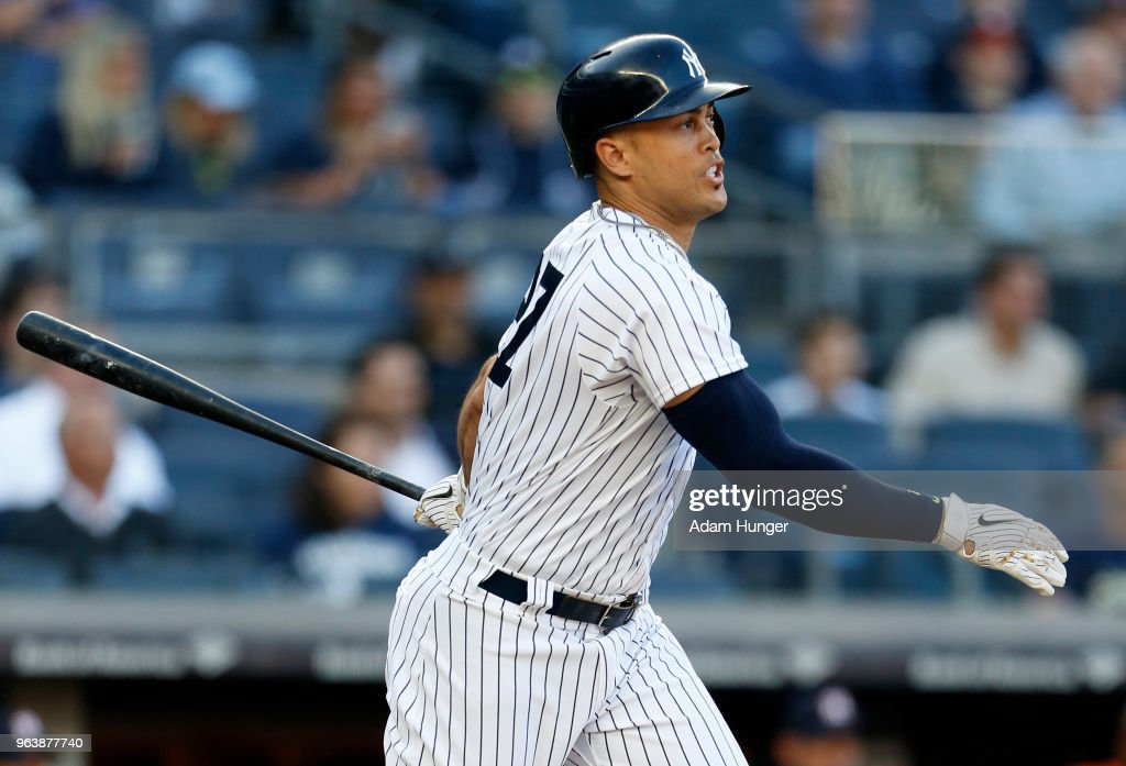 Giancarlo Stanton #27 of the New York Yankees watches a sacrifice fly against the Houston Astros during the first inning at Yankee Stadium on May 30, 2018 in the Bronx borough of New York City.
