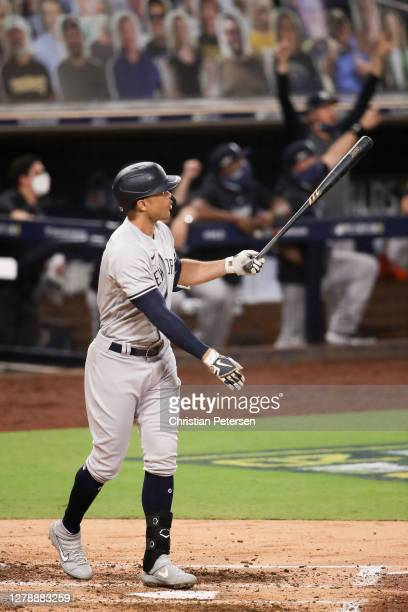 Giancarlo Stanton of the New York Yankees watches his three run home run leave the park against the Tampa Bay Rays during the fourth inning in Game...