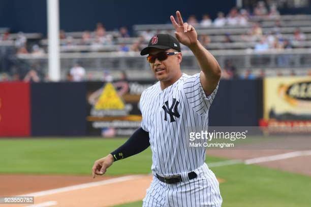 Giancarlo Stanton of the New York Yankees waves to the crowd during player introductions prior to the Spring Training game against the Detroit Tigers...