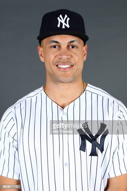 Giancarlo Stanton poses for a headshot after being introduced as a member of the New York Yankees during the 2017 Winter Meetings at the Walt Disney...