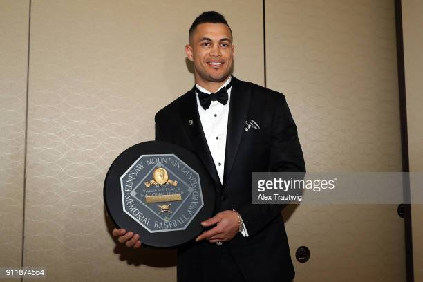 Giancarlo Stanton poses with his National League MVP award during the 2018 Baseball Writers' Association of America awards dinner on Sunday January...