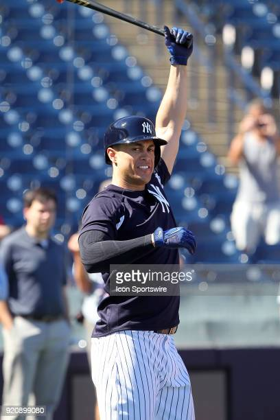 Giancarlo Stanton stretches as he waits for his turn in the batting cage during the New York Yankees spring training workout on February 19 at George...