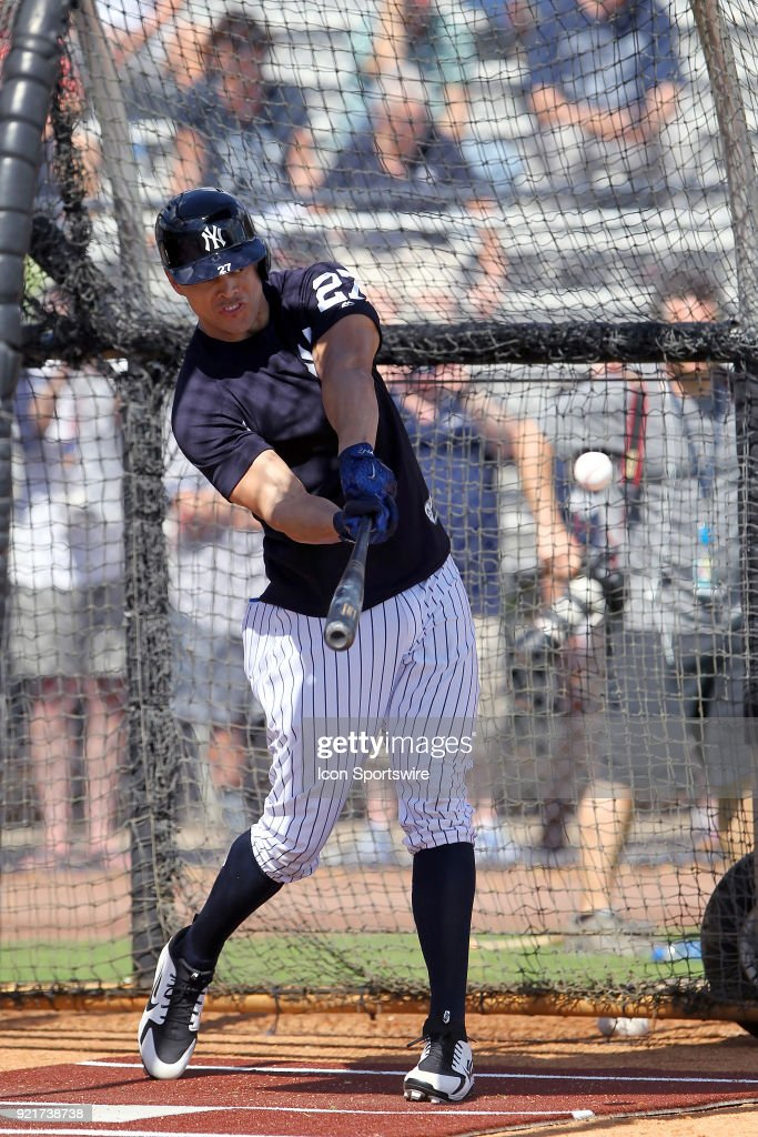 Giancarlo Stanton (27) takes a swing during batting practice during the New York Yankees spring training workout on February 20, 2018, at George M. Steinbrenner Field in Tampa, FL.