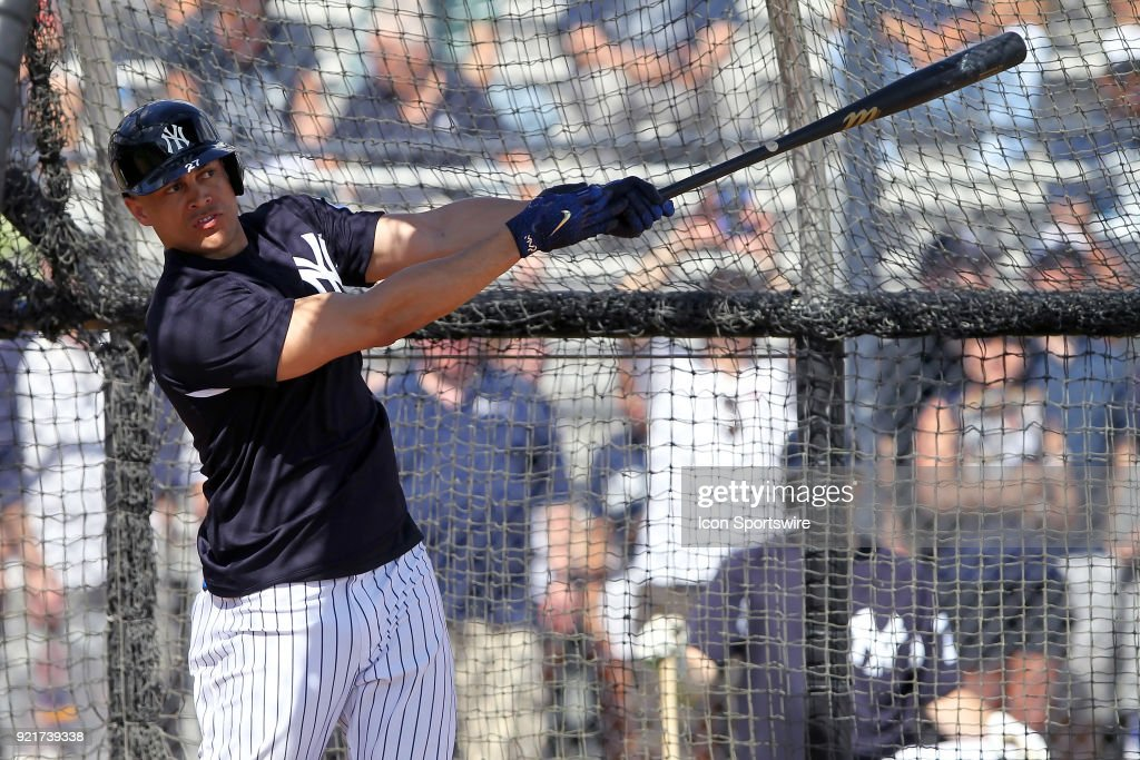 Giancarlo Stanton (27) takes a swing while in the batting cage during the New York Yankees spring training workout on February 20, 2018, at George M. Steinbrenner Field in Tampa, FL.