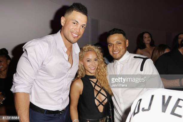Giancarlo Stanton Tammy Torres and AJ Ramos attend the TMobile Presents Derby After Dark at Faena Forum on July 10 2017 in Miami Beach Florida