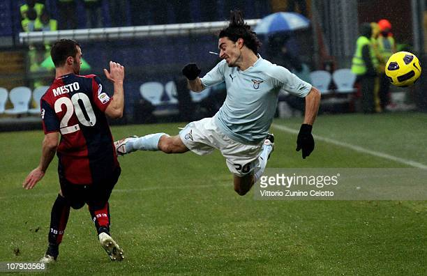 Giandomenico Mesto of Genoa CFC competes for the ball with Giuseppe Biava of SS Lazio during the Serie A match between Genoa and Lazio at Stadio...