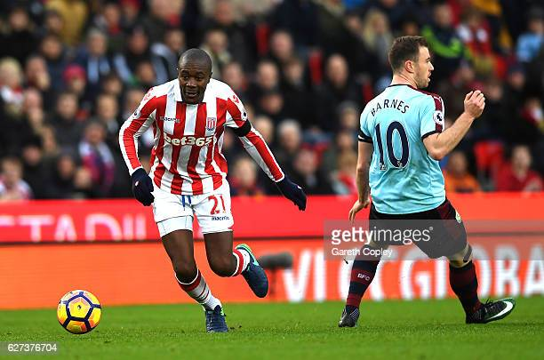 Gianelli Imbula of Stoke City evades Ashley Barnes of Burnley during the Premier League match between Stoke City and Burnley at Bet365 Stadium on...