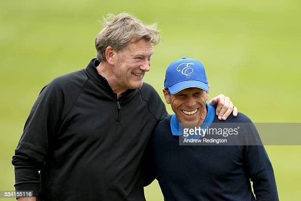 Gianfranco Zola and Glenn Hoddle react on the 18th green during the ProAm prior to the BMW PGA Championship at Wentworth on May 25 2016 in Virginia...