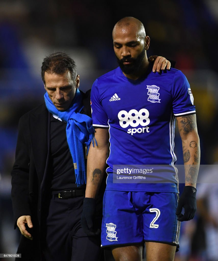 Gianfranco Zola of Birmingham City consoles Emilio Nsue after defeat in the Sky Bet Championship match between Birmingham City and Leeds United at St Andrews (stadium) on March 3, 2017 in Birmingham, England.
