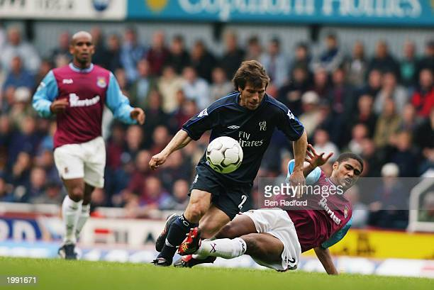 Gianfranco Zola of Chelsea is tackled by Glen Johnson of West Ham United during the FA Barclaycard Premiership match held on May 3 2003 at Upton Park...