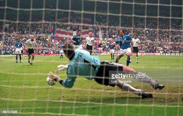 Gianfranco Zola of Italy fails to score a penalty against goalkeeper Andreas Koepke of Germany during the European Championship final round group 3...
