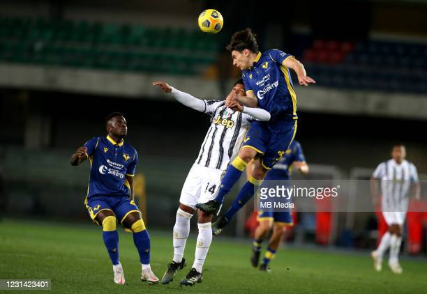 Giangiacomo Magnani of Hellas Verona FC head the ball against Weston McKennie of Juventus ,during the Serie A match between Hellas Verona FC and...