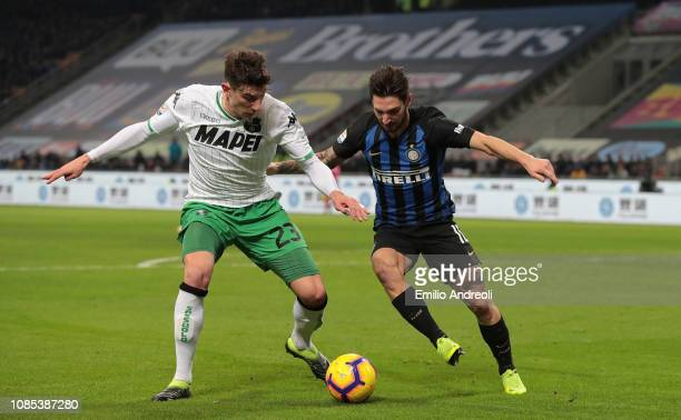Giangiacomo Magnani of US Sassuolo is challenged by Matteo Politano of FC Internazionale during the Serie A match between FC Internazionale and US...