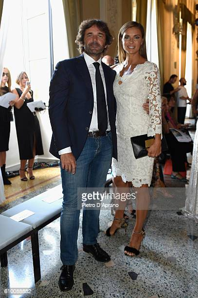 Gianguido Tarabini and Martina Colombari attend the Blumarine show during Milan Fashion Week Spring/Summer 2017 on September 24 2016 in Milan Italy