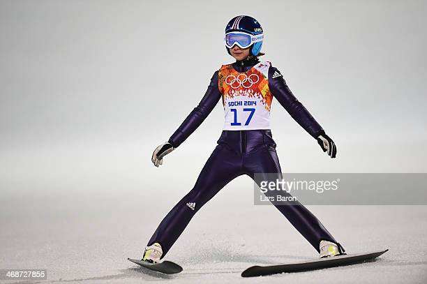 Gianina Ernst of Germany lands her jump during the Ladies' Normal Hill Individual first round on day 4 of the Sochi 2014 Winter Olympics at the...