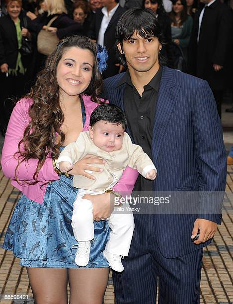 Gianina Maradona and Sergio 'Kun' Aguero leave the Nuestra Senora de Balvanera Church with their son Benjamin after his christening on June 20 2009...
