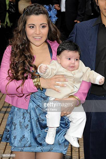 Gianina Maradona leaves the Nuestra Senora de Balvanera Church with her son Benjamin after his christening on June 20 2009 in Buenos Aires Argentina