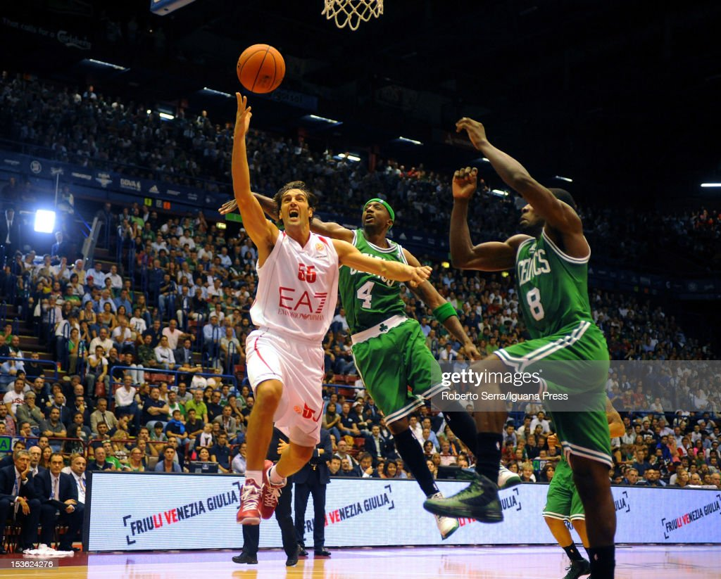 Gianluca Basile # 55 of Armani competes with Jeff Green # 8 and Jason Terry # 4 of Celtics during the NBA Europe Live game between EA7 Emporio Armani Milano v Boston Celtics at Mediolanum Forum on October 7, 2012 in Milan, Italy.