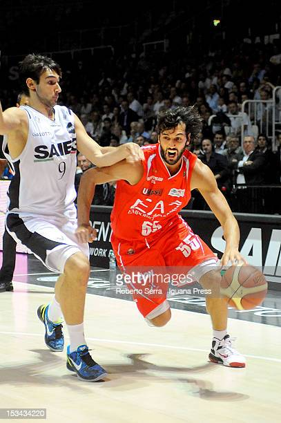 Gianluca Basile of EA7 competes with Riccardo Moraschini of SAIE3 during the Lega Basket Serie A match between SAIE3 Bologna and EA7 Emporio Armani...