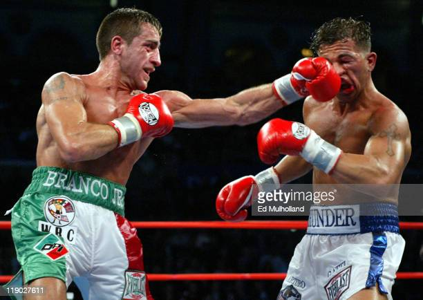 Gianluca Branco lands a hard left to the head of Arturo Gatti during their 12 round fight for the vacant WBC Junior Welterweight Championship Gatti...