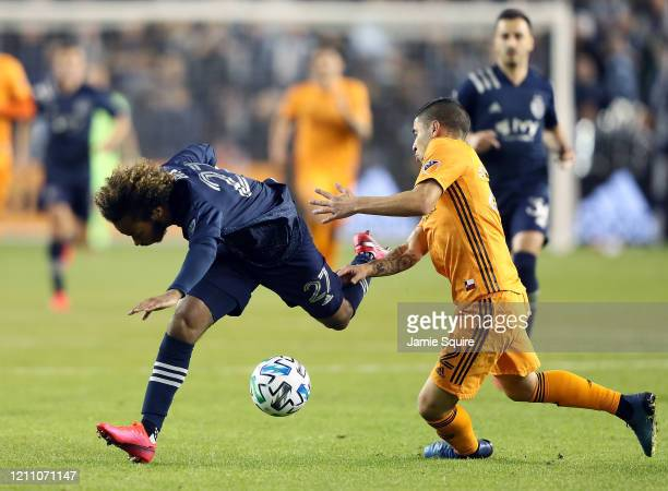 Gianluca Busio of Sporting Kansas City is tripped by Matias Vera of Houston Dynamo during the game at Children's Mercy Park on March 07 2020 in...