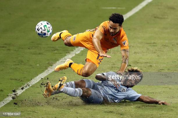 Gianluca Busio of Sporting Kansas City makes a sliding tackle on Niko Hansen of Houston Dynamo during the second half at BBVA Stadium on October 03,...