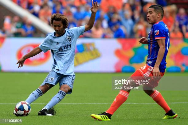 Gianluca Busio of the Sporting Kansas City makes a move on Victor Ulloa of the Cincinnati FC during the first half at Nippert Stadium on April 07...