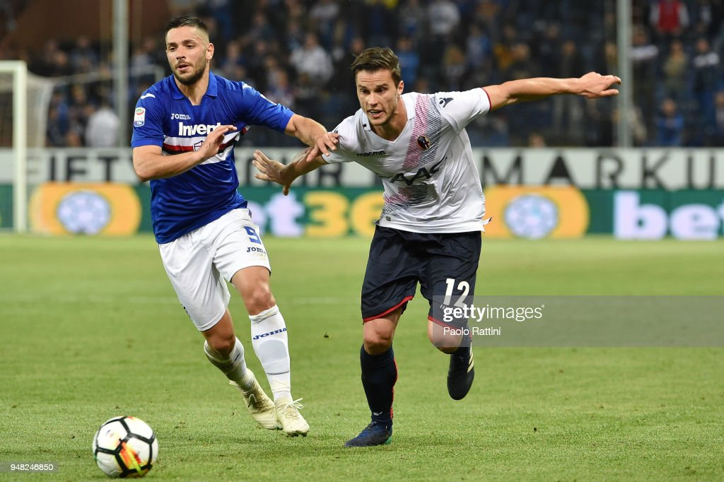 Gianluca Caprari of Sampdoria oppose to Lorenzo Crisetig of Bologna during the serie A match between UC Sampdoria and Bologna FC at Stadio Luigi Ferraris on April 18, 2018 in Genoa, Italy.