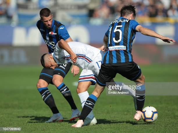 Gianluca Caprari of UC Sampdoria competes for the ball with Hans Hateboer and Marten De Roon of Atalanta BC during the Serie A match between Atalanta...