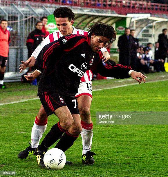 Gianluca Comotto of Vicenza and Francesco Coco of AC Milan during the SERIE A 18th Round League match between Vicenza and AC Milan played at the...