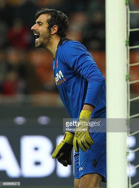 Gianluca Curci of Bologna FC shouts to his teammates during the Serie A match between AC Milan and Bologna FC at San Siro Stadium on February 14 2014...