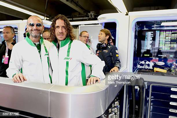 Gianluca Di Tondo Senior Director Global Heineken Brand and Heineken ambassador Carles Puyol in the Red Bull Racing garage during practice for the...
