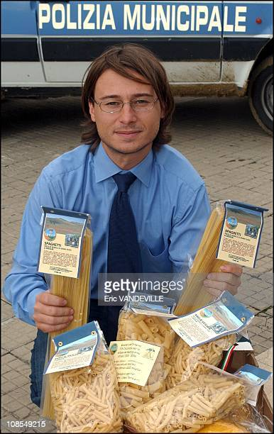 Gianluca Faraone President of the Association 'Libera' at San Giuseppe Jato near Palermo with pasta made from wheat grown on the lands seized from...